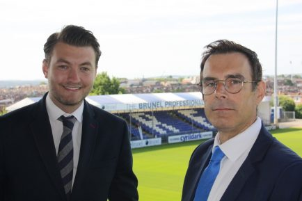 Tom Corringe, Commercial Director of Bristol Rovers, and Russell Lane, CEO of Brunel Group in front of the Brunel stand