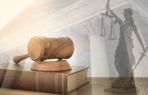 Judge gavel on law books with statue of justice and court government background. concept of law, justice, legal.
