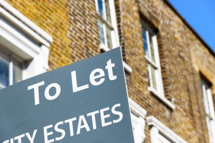 To Let property agency sign posted outside English terraced houses in Poplar, East London
