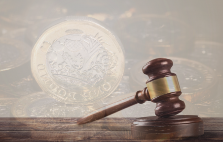 Gavel and pound coin