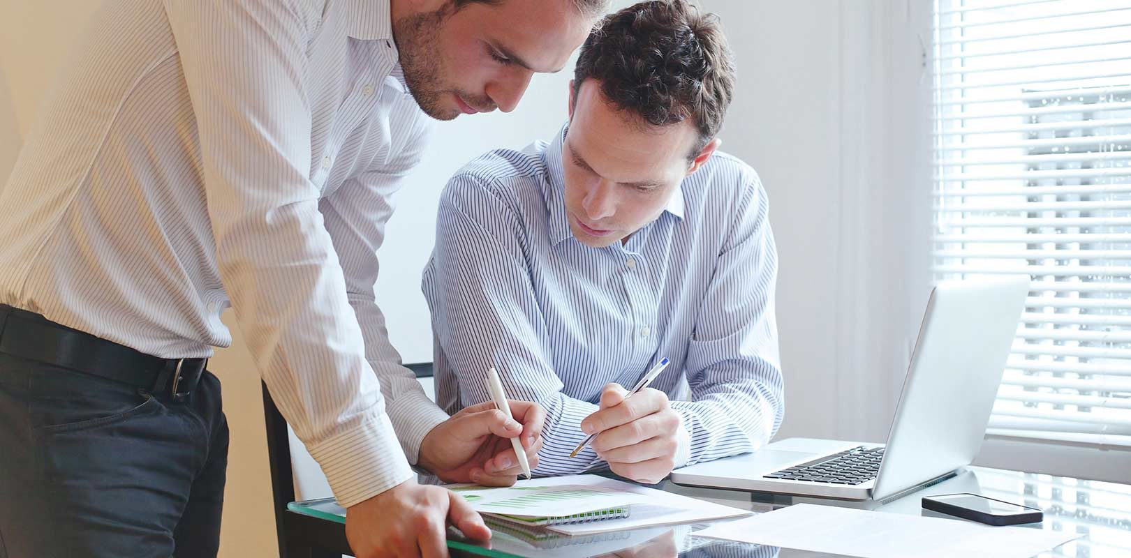 Financial advisors looking over documents