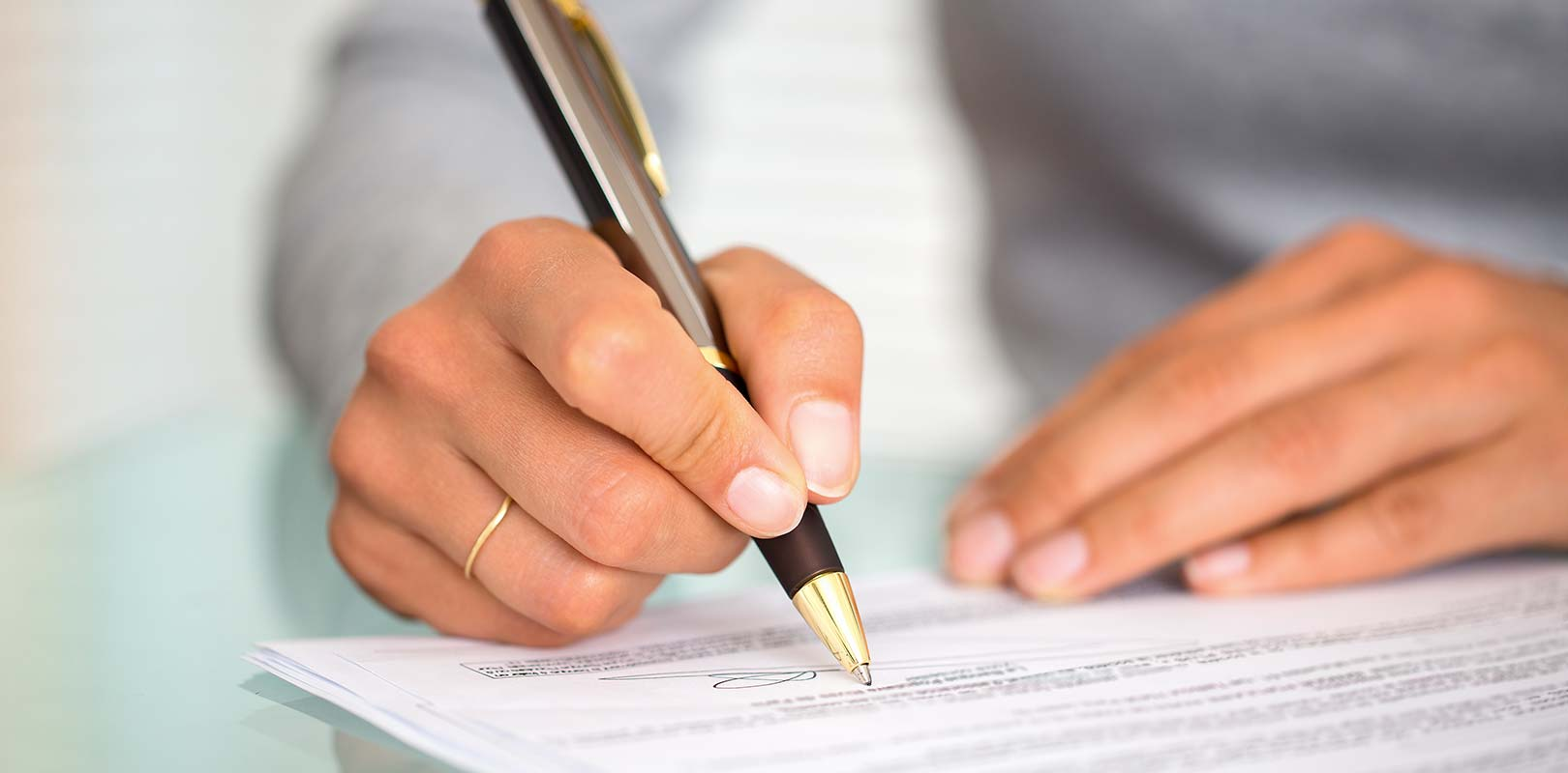 A manager signing an insurance policy