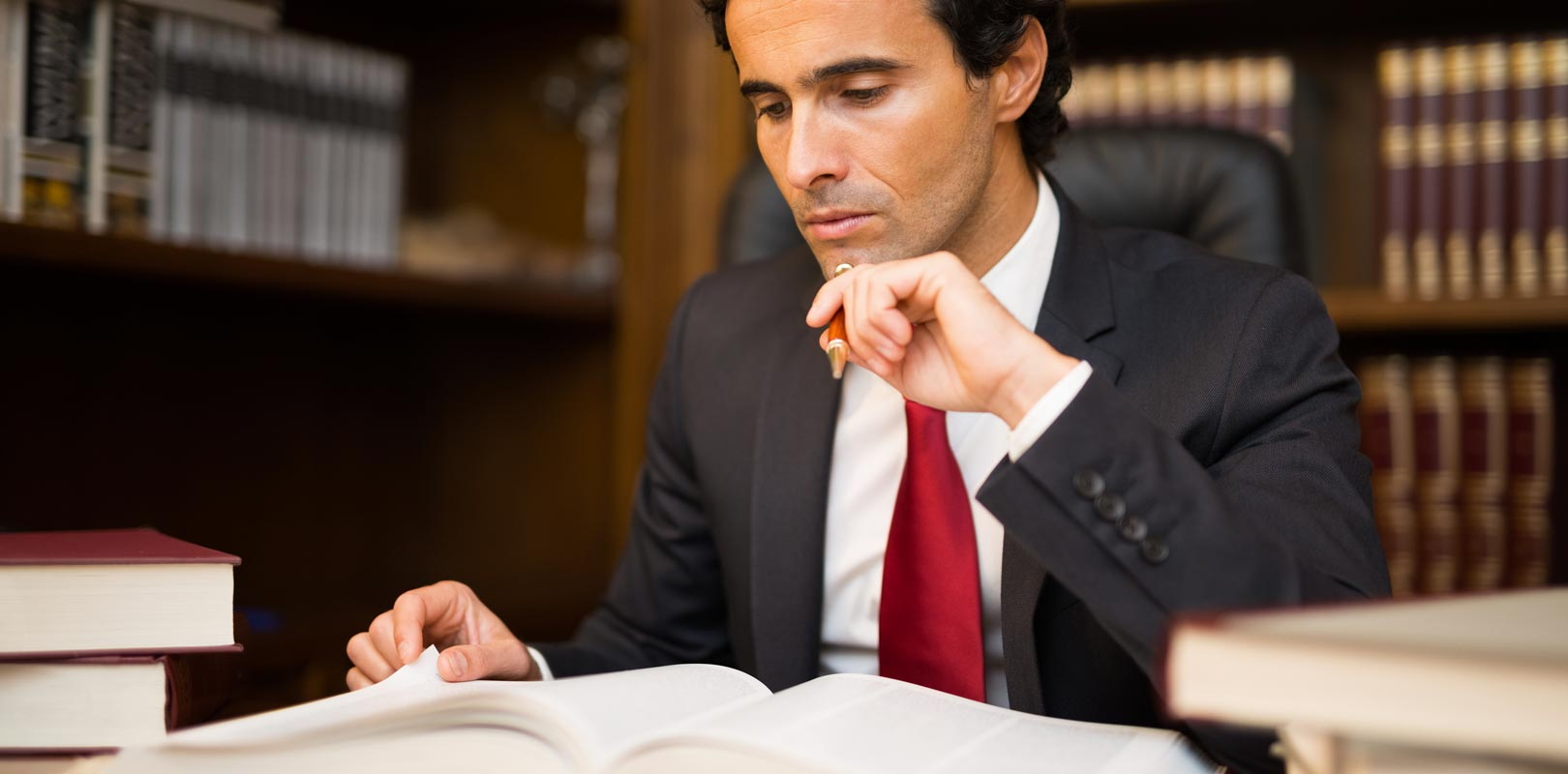 A solicitor studying a law book