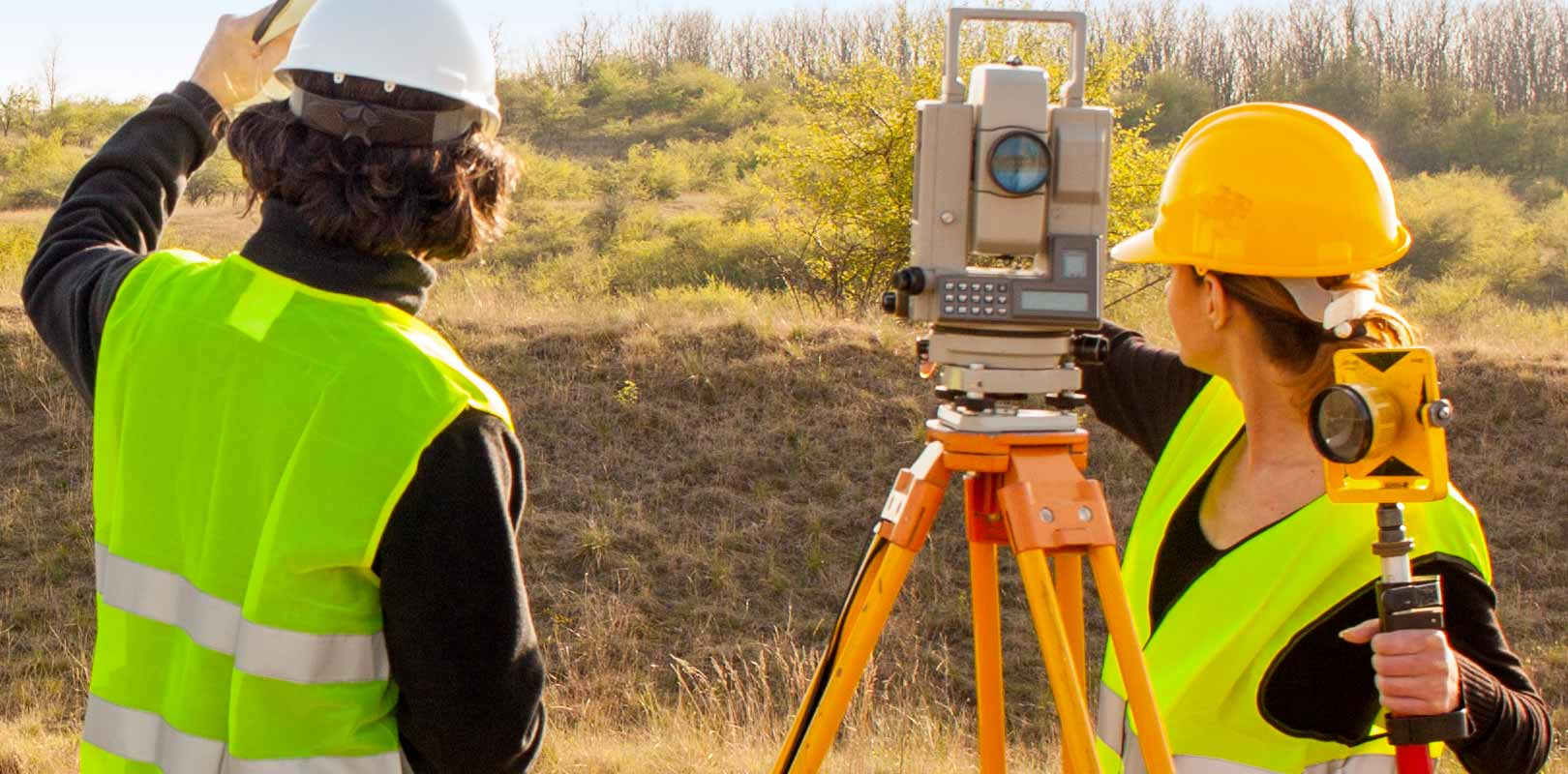 Surveyors surveying land for property development