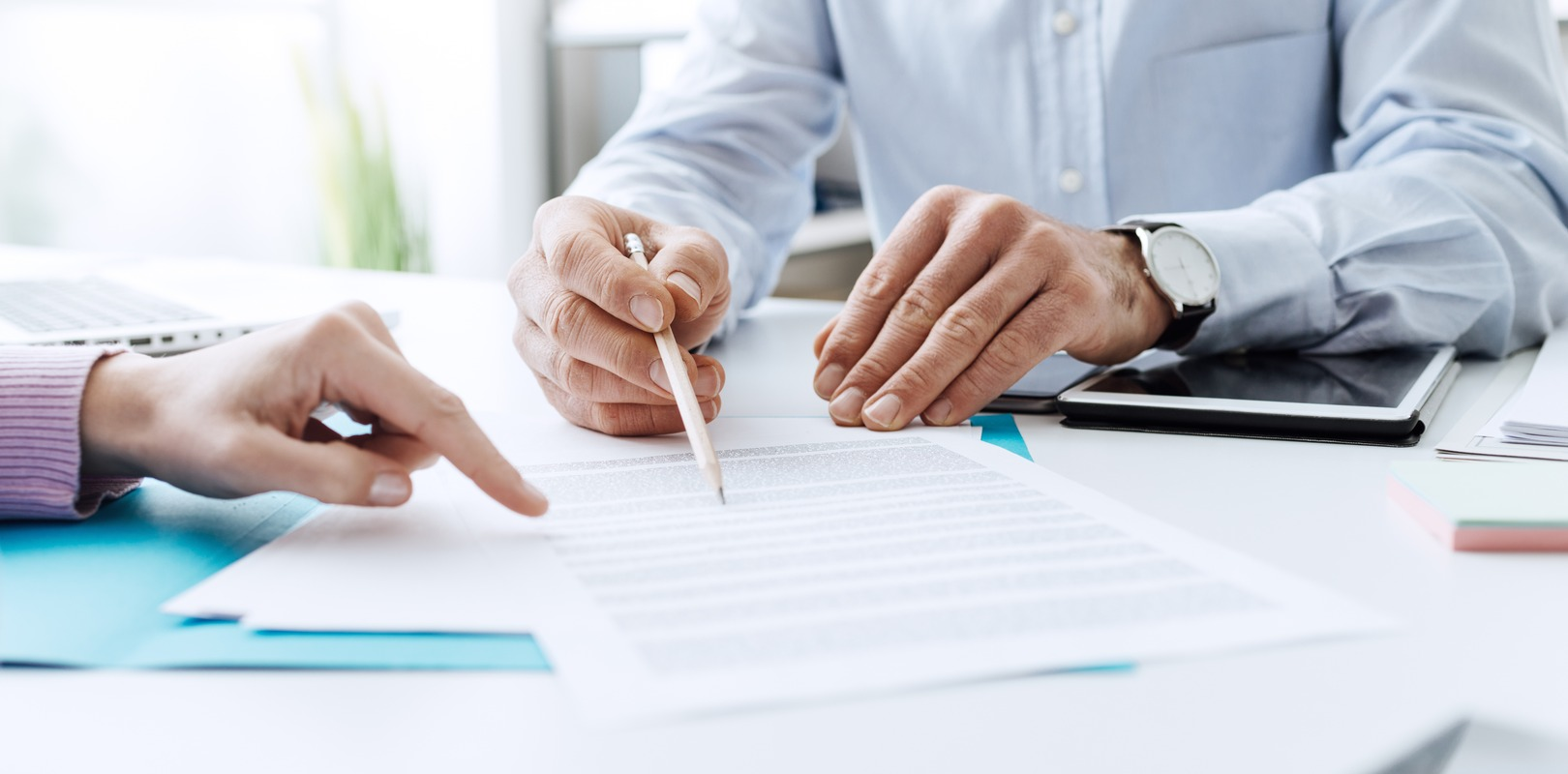 Insurance broker reviewing contract terms